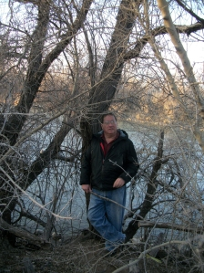 The blogger standing on the bank of the San Juan River in Farmington, NM.