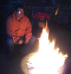 The blogger relaxing by the front yard firepit on a chilly New Mexico evening.